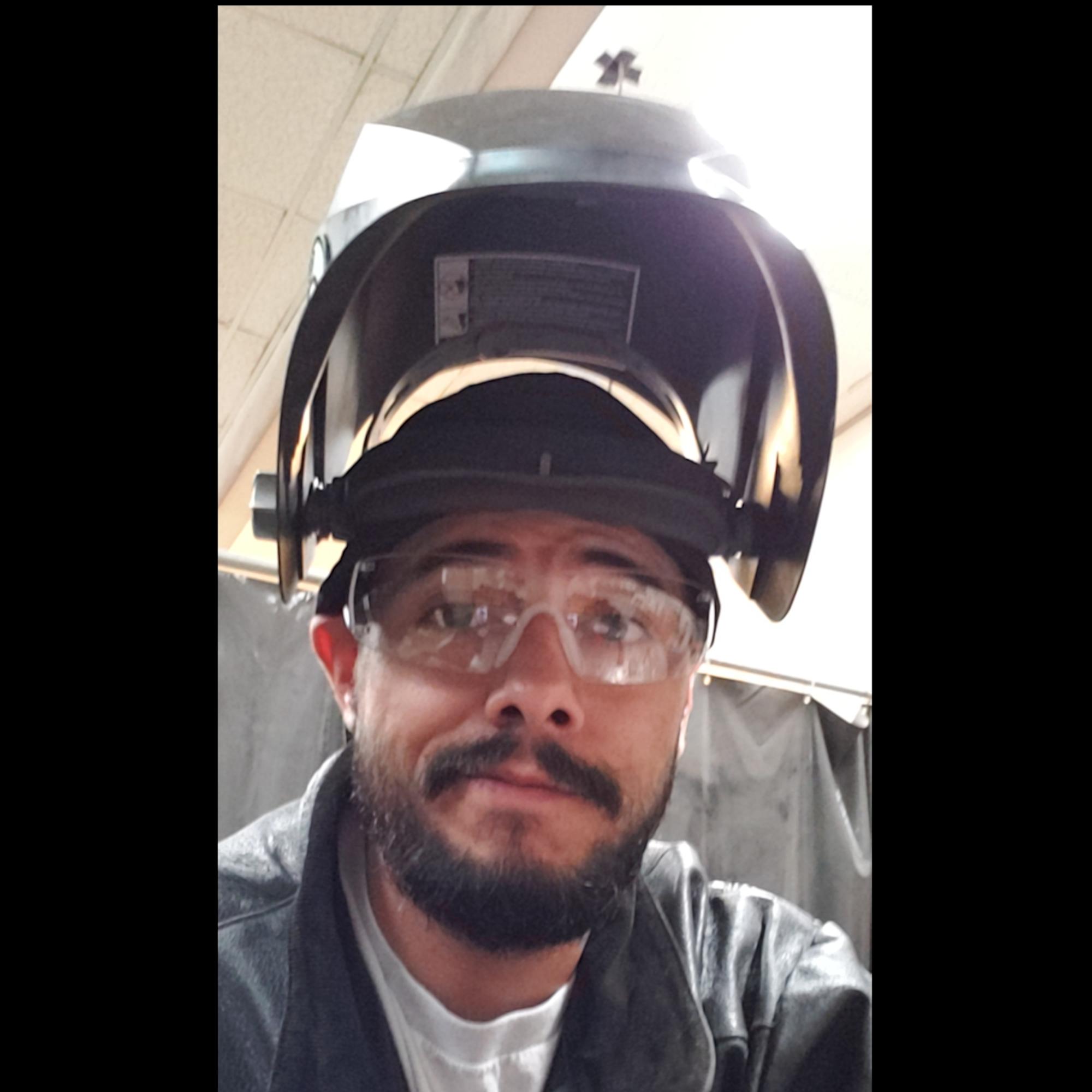 Jonathan (Jonny) Gonzales with Welding Helmet